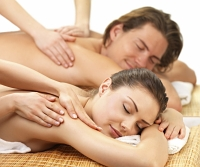 Young man and woman receiving back massage